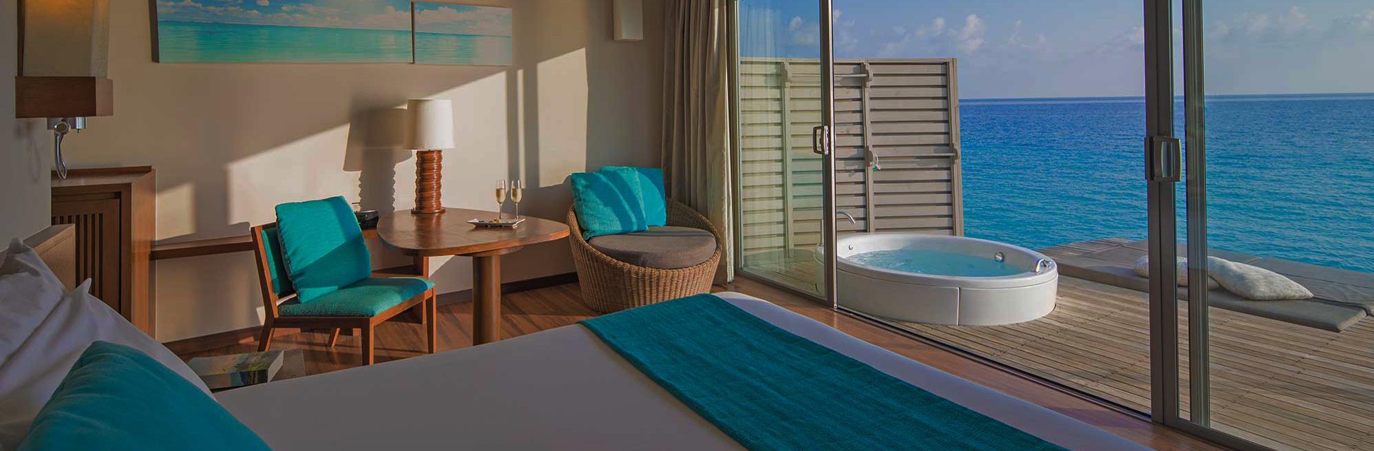Ras Fushi maldives 06 premium deluxe spa water villa 08 2000x925 1